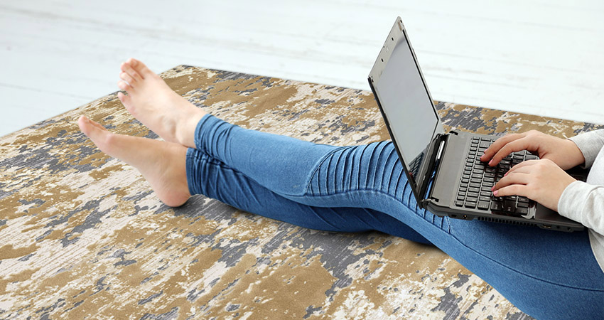 Woman with a laptop on the floor
