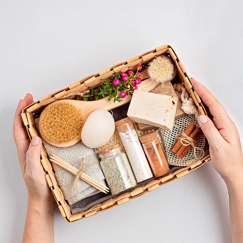 Preparing self care package, seasonal gift box with zero waste cosmetics vs industrial plastic products. Personalized eco friendly basket for family and friends. Alternative sustainable lifestyle